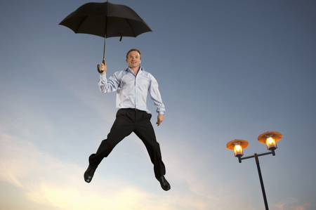 dry suit: Businessman floating with an umbrella LANG_EVOIMAGES