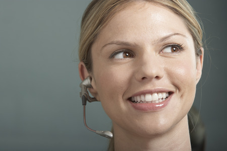 earpiece: Close-Up portrait of Business woman with telephone headset  earpiece.