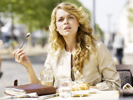 Woman eating at an outdoor restaurant