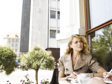 appointment book: Woman at an outdoor restaurant LANG_EVOIMAGES
