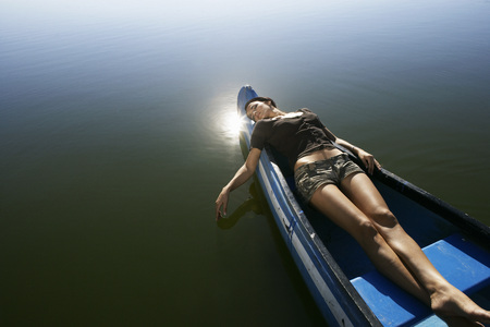 Young woman asleep in Canoe.