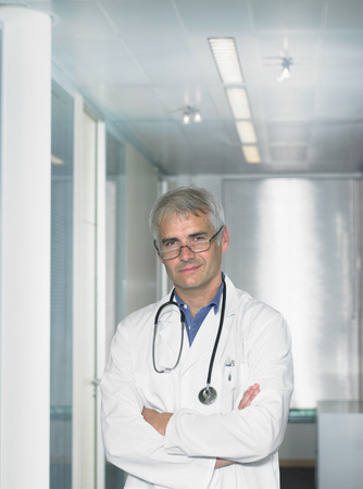 md: Portrait of mature male doctor in a lobby of a hospital.