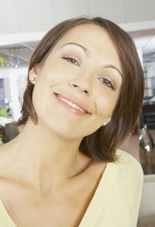 customer facing: Close up portrait of woman smiling.