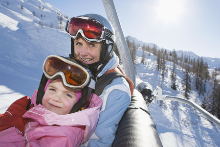 wintery: Young girl and grandmother on chair lift
