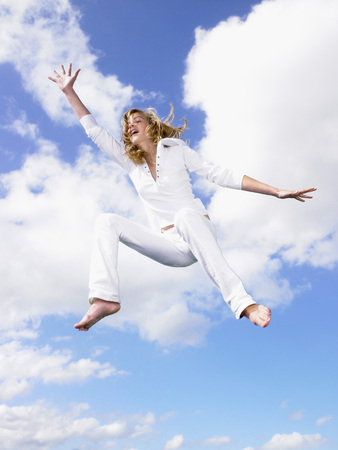 Girl jumping in the air. LANG_EVOIMAGES