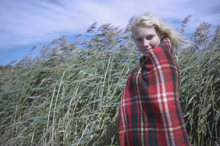 Young Woman in tartan blanket.