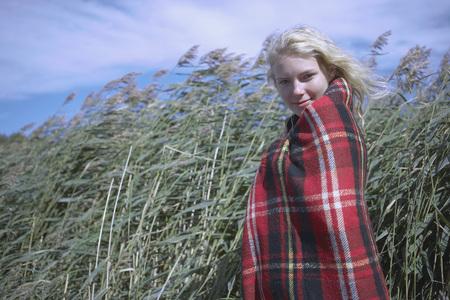 get away: Young Woman in tartan blanket.