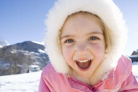 furs: Portrait of young girl in the snow