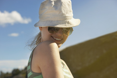 sunhat: Young woman wearing sun hat.