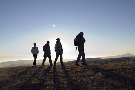 ruck sack: 4 people on a trek. LANG_EVOIMAGES