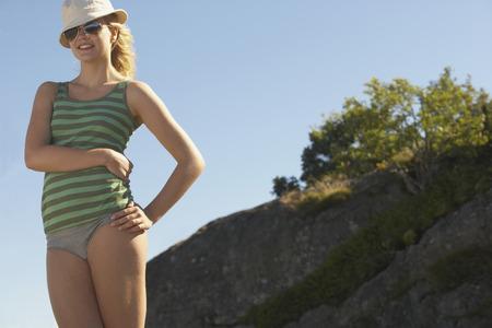 Young woman wearing sun hat.