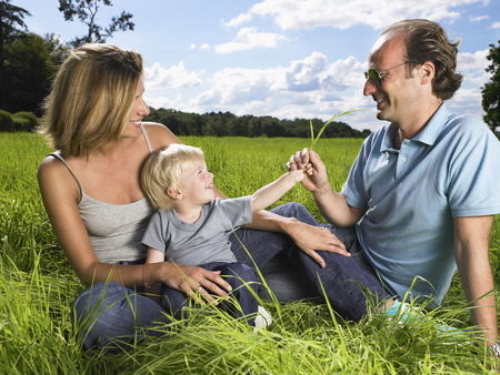 Family enjoying a good time in a field.