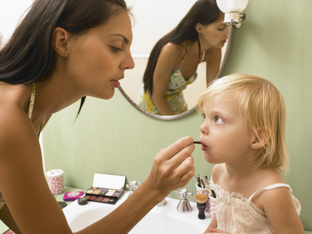 sinks: Mother and daughter applying makeup.