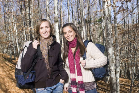 late twenties: Portrait of 2 young women in the woods. LANG_EVOIMAGES