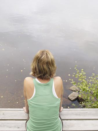 Woman sitting on dock.