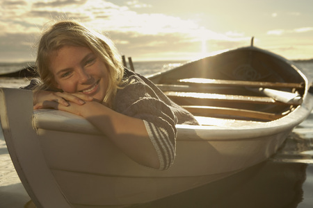 simple girl: Young woman in rowing boat.