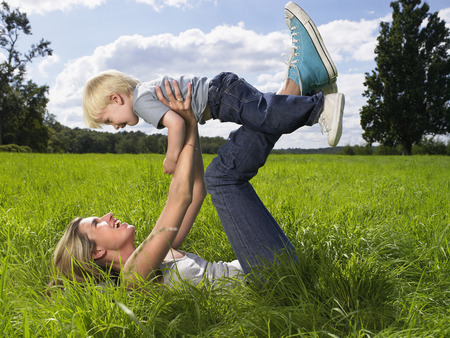 Mother and son playing in a field.