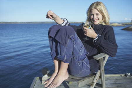 Young Woman relaxing on jetty.