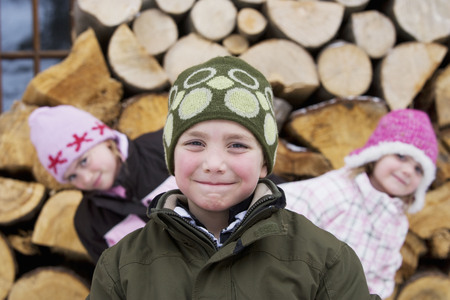 Children posing with winter hats on LANG_EVOIMAGES