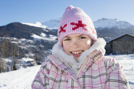 Portrait of young girl in the snow