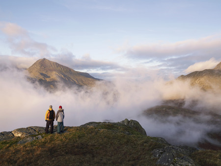 Couple in mountain landscape. LANG_EVOIMAGES