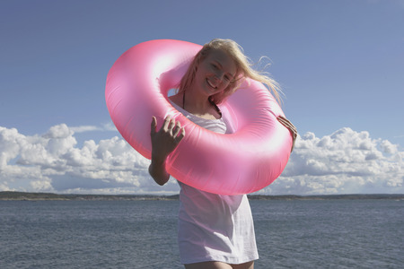 get away: Young woman with swimming ring.