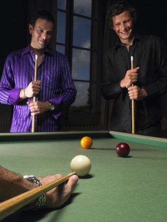 pool cues: Men playing snooker
