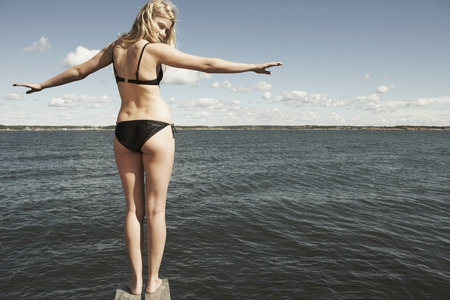 get away: Young woman on diving platform. LANG_EVOIMAGES