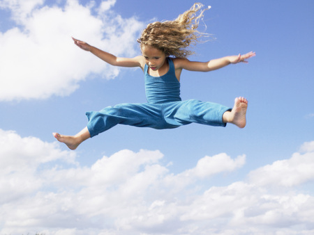 Young girl jumping in the air. LANG_EVOIMAGES
