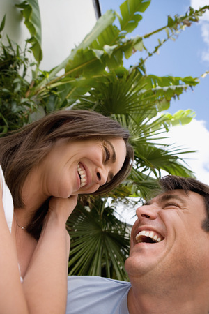 embraced: Portrait of a happy couple. LANG_EVOIMAGES
