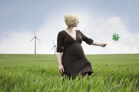 accountable: Pregnant woman playing with windmill LANG_EVOIMAGES