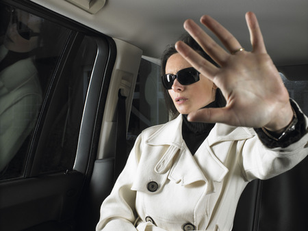 Woman in car, sunglasses on LANG_EVOIMAGES