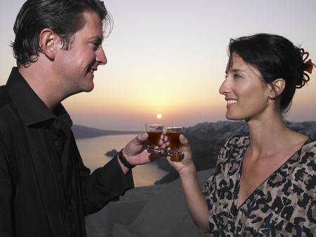 sightseers: Man and woman toasting their glasses