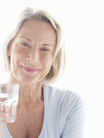 gals: Mature woman drinking water
