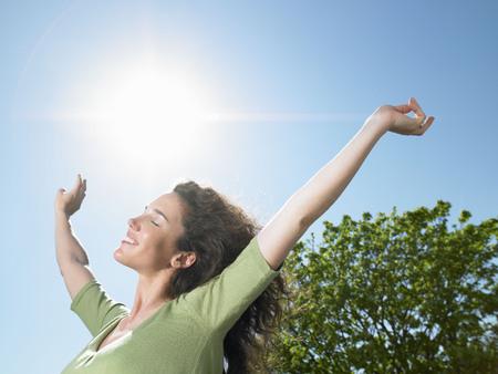 rejuvenated: Woman enjoying the sun