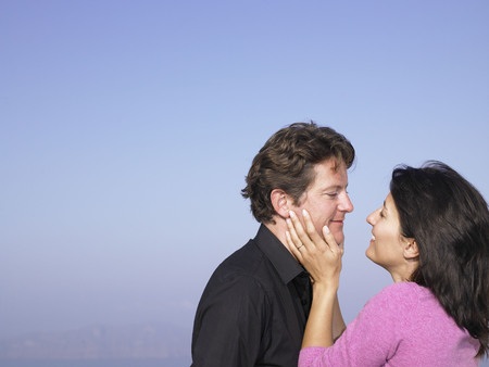 honeymooner: Men and woman smiling at each other
