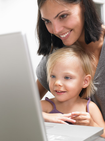 accountable: Mother and daughter looking at a laptop