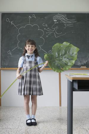 teaches: School girl giving science presentation