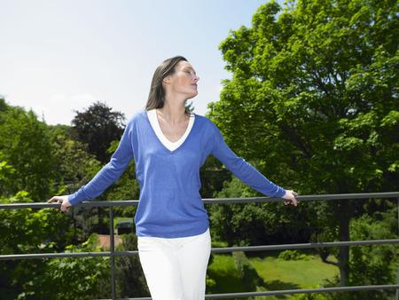 rejuvenated: Woman enjoying the sun, on the terrace