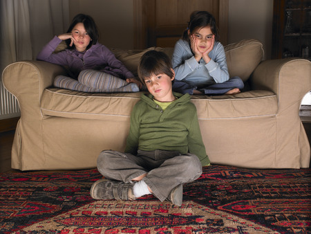concentrate: Children on sofa, watching tv