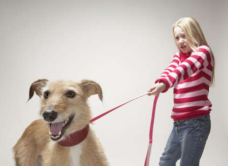 lurcher: Girl pulling a lurcher on lead