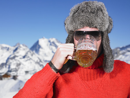 negative area: Young man having drink at mountains LANG_EVOIMAGES
