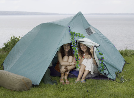 safe water: Two women looking out from tent