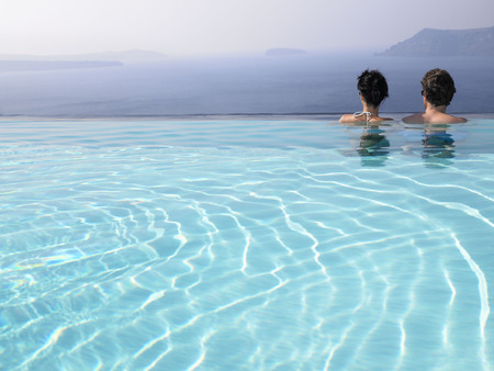 honeymooner: Couple in swimming pool