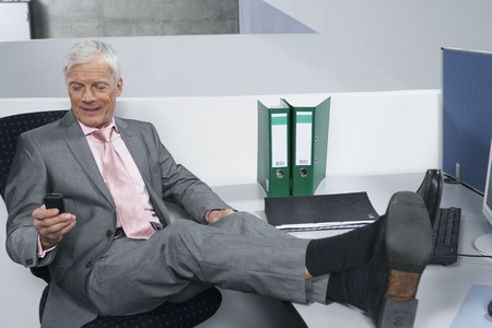 joining forces: Man with feet on desk