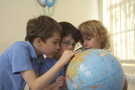finds: Boys looking at an earth globe