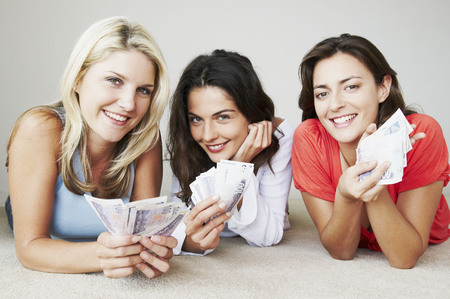 gals: Three happy woman hold banknotes