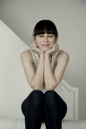 bashfulness: Portrait of a woman on a sofa