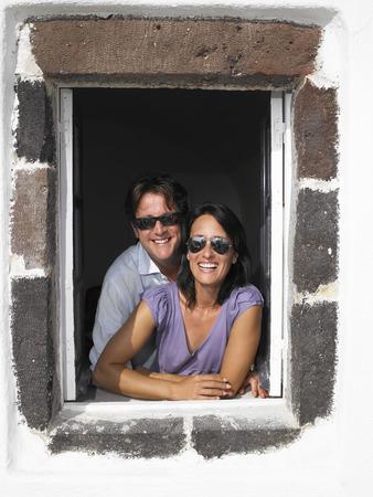 honeymooner: Couple looking through window, smiling