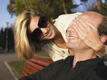 Couple smiling, outdoors LANG_EVOIMAGES